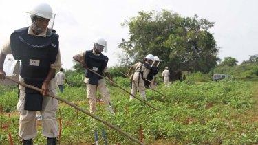 Frontline ... Yogalingam Rubaganthy, 29, clears landmines.