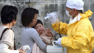 Trying to stay safe ... a one-year-old boy is rechecked for radiation at Nihonmatsu, Fukushima.
