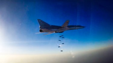A Russian long range bomber flies during an air strike over Aleppo.