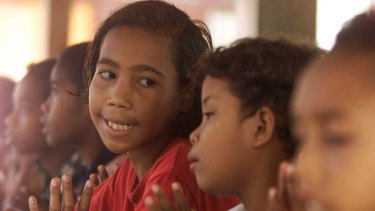 Power of prayer … East Timorese refugee children in an orphanage near Yogyakarta, Central Java, in 2001.