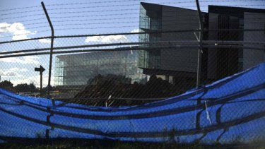 The new ASIO building will not open for at least several more months, behind schedule and over budget.