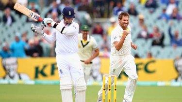 Ryan Harris celebrates after taking the wicket of Graeme Swann.