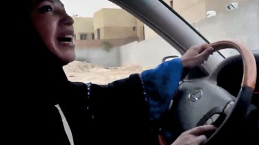 A Saudi Arabian woman drives a car as part of a campaign to defy Saudi Arabia's ban on women driving, in Riyadh, Saudi Arabia.