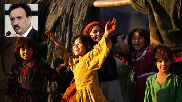 Despite the political crisis engulfing Pakistan, a bunch of Afghan refugee girls find plenty to smile about as they play in a poor neighbourhood in Rawalpindi. Inset: Interior Minister Rehman Malik.