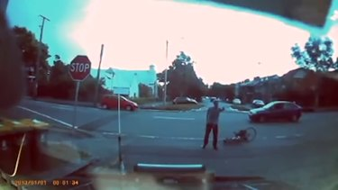 The cyclist gestures towards the fleeing vehicle.