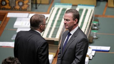High-pitched battle ... Anthony Albanese and Christopher Pyne talk on the floor of Parliament.