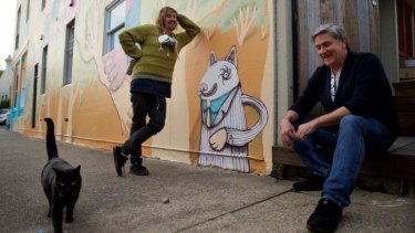 """The more you restrict the freedom of artists to create the imagery they choose, the more you force out the true grittiness of the culture,"" street artist Birdhat (left) with cafe owner Dale Chaffey."