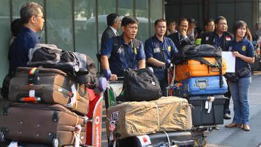Indonesian body identification experts arrive at Melbourne Airport to assist local police with the large workload from the bushfires.