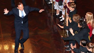 A step to the left: Prime Minister Tony Abbott gives young visitors to the Great Hall an offbeat welcome.