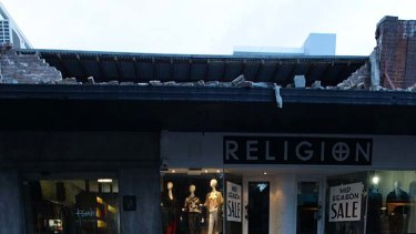 Weather damage ... strong winds tore the roof off a shop in Bondi.