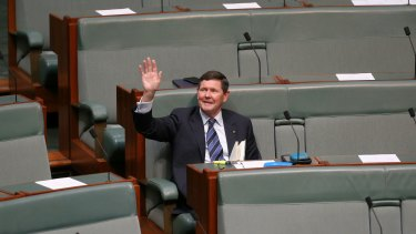 Father of the House Kevin Andrews waves to the public gallery in Parliament House.