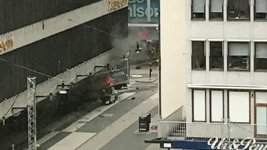 The scene shortly after a truck crashed into a department store in central Stockholm on Friday.