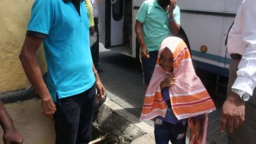 A young asylum seeker turns up at court in Galle, Sri Lanka, after being transferred by Australia to the Sri Lankan navy.