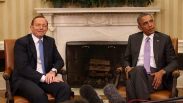 The famous wink: Prime Minister Tony Abbott with US President Barack Obama this week.