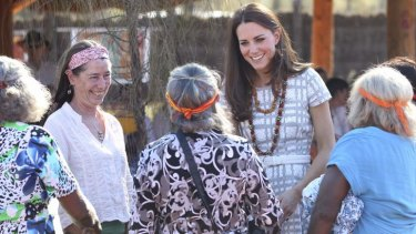 Soaring spirits: The Duchess of Cambridge meets artists at Uluru.