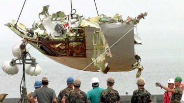 US  Army National Guard soldiers look on as the cockpit from TWA Flight 800 is recovered at Hampton Bays, New York,  in 1996.  All 230 people aboard the Paris-bound 747 died when the jet exploded shortly after take-off.