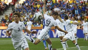 Penalty ... Italy's Daniele De Rossi falls to the ground after a challenge by Tommy Smith was judged a foul.