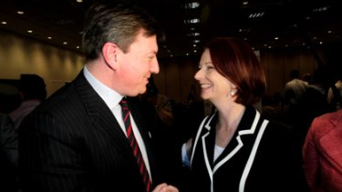 Former NSW opposition leader John Brogden and Prime Minister Julia Gillard in Brisbane today.
