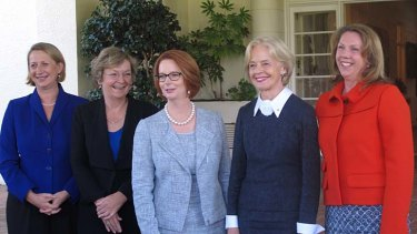 Julia Gillard pictured last week with female government officials.