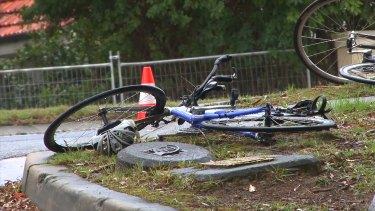 A bicycle lies abandonded near the site a woman was killed after a collision with a car on Mona Vale Road.