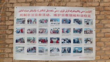 A poster at a village mosque sets out religious practices forbidden by the authorities.