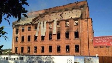 The charred remains of the Albion flour mill. Photo: Alyshia Gates/Nine News, via Twitter.