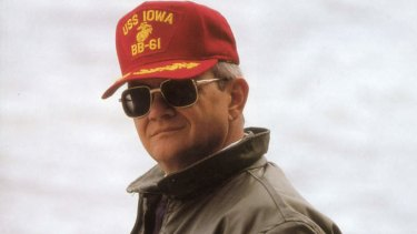 Author Tom Clancy wearing cap which reads on it USS Iowa BB-61, pictured in 2000.