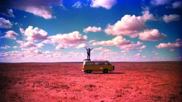 Yeldham on top of his Kombi in Sturt National Park, NSW in 1996.