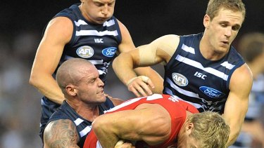 Costly: Cat Josh Hunt copped a two-game ban for this sling tackle on Swan Luke Parker.