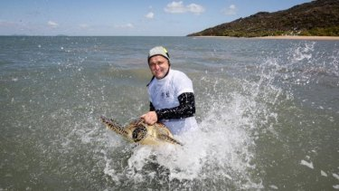 Christophe Tourenq Wetland Manager, Banrock Station with a Green Turtle.