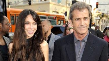 Short, dark and handsome ... Mel Gibson with partner Oksana Grigorieva.