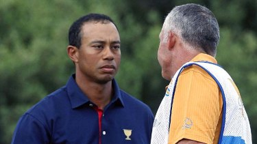 Firm grip: Tiger Woods and former caddie Steve Williams yesterday.