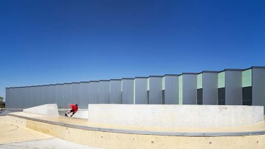 Multifunctional: A skateboarder tests out the bowl in front of the new Taylors Hill Youth Community Centre.