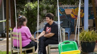 Help at hand: Beryl Women Inc worker Robyn Martin, right, with a client at the refuge in the ACT.