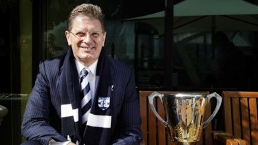 Geelong fan Premier Ted Baillieu with the AFL Premiership Cup.