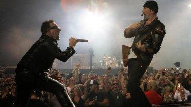 U2's Bono and The Edge perform at Etihad stadium in 2010.