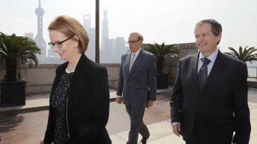 Prime Minister Julia Gillard with ministers Senator Bob Carr and Bill Shorten in China. The government has called Coalition senator Barnaby Joyce's comments on trade with China 'reckless'.