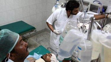 Libyan medics treat a wounded man at a hospital.
