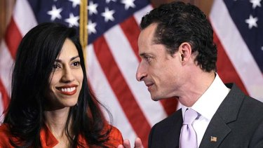 Standing by her man: Huma Abedin and her husband Anthony Weiner.