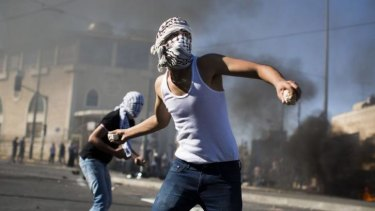 Palestinian youths clash with Israeli police near the house of murdered Palestinian teenager Mohammad Abu Khieder.