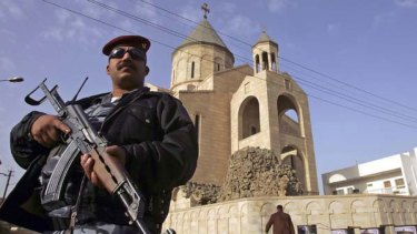 An Iraqi policeman at the Sayidat al-Nejat church.
