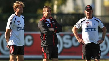 Former Geelong assistant coach, Brendan McCartney, with James Hird and Mark Thompson at Essendon.