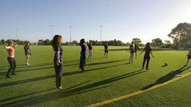 Mill Park Secondary College students at soccer training with Shaun Isbister. <i>Picture: Simon O'Dwyer</i>