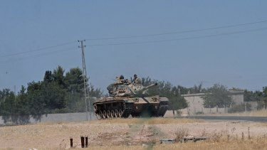 A Turkish tank on its way to the Syrian border.