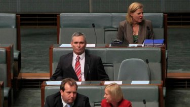 Craig Thomson, centre, during question time today.