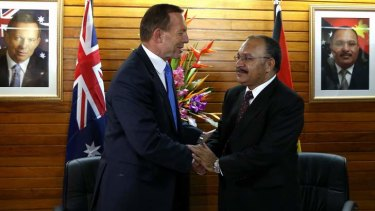 Backflip of refugee resettlement: Prime Minister Tony Abbott and PNG Prime Minister Peter O'Neill.