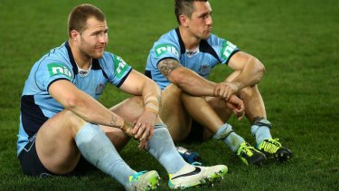 Ups and downs: Roosters halfback Mitchell Pearce suffers the sting of defeat after NSW lost the decider.