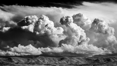 From <i>brindabellas</i>: storms passing behind Tuggeranong, from Scrivener Hill.