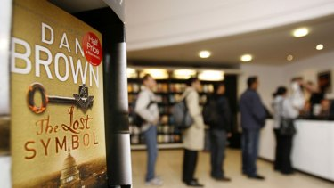 "People queue to buy a signed copy of the new Dan Brown novel ""The Lost Symbol"" at a bookshop in London."
