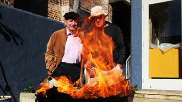 Charles Blackman and Robert Dickerson watch as three paintings falsely ascribed to them go up in smoke yesterday.